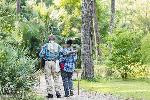 istock Senior African-American couple hiking, exploring 1094682172