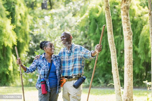 istock Senior African-American couple hiking, exploring 1094682290