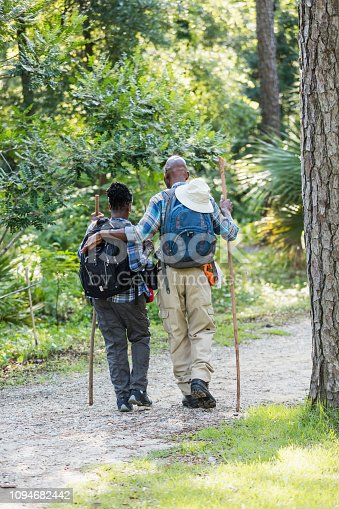 istock Senior African-American couple hiking, exploring 1094682442