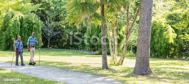 istock Senior African-American couple hiking in park 1094682064