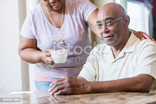 istock Senior African-American man at home with adult daughter 926397990
