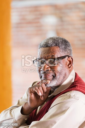 611876426 istock photo Senior African-American man, hand on chin 1091124000