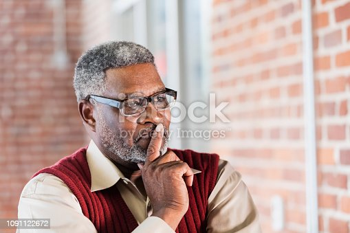 istock Senior African-American man, hand on chin, thinking 1091122672