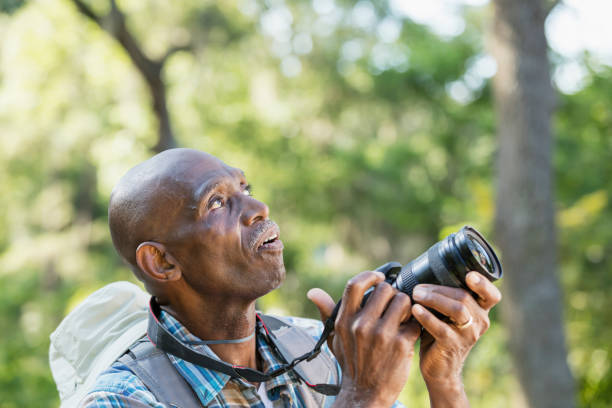 Senior africanamerican man hiking with camera picture id1023569620?b=1&k=6&m=1023569620&s=612x612&w=0&h= xhyjeizdqi5pooef1fzwatz h37lo6uxtpniosnxng=