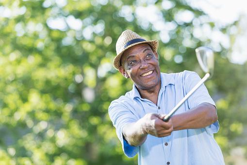 istock Senior African-American man practicing golf swing 926397172