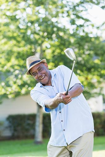 istock Senior African-American man practicing golf swing 926397506