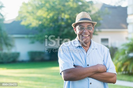 istock Senior African-American man standing in front yard 898439420