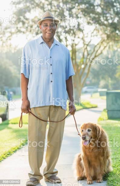 Senior africanamerican man walking his dog picture id898439440?b=1&k=6&m=898439440&s=612x612&h=dyagy7mc5psgbvvqenhk0wjfc luwjp5urfyj6e1juy=