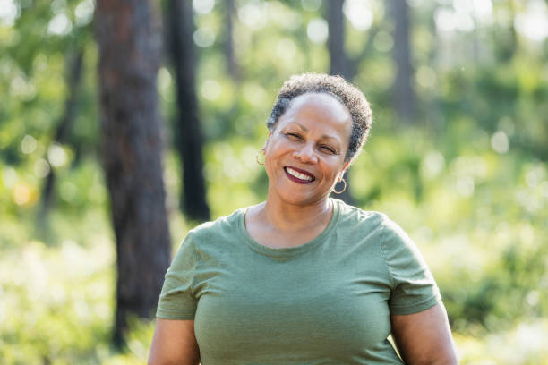 Senior African-American woman at a park stock photo