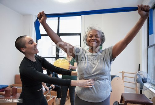 istock Senior african-american  woman doing exercise 1256519671
