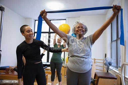 istock Senior african-american  woman doing exercise 1256519734