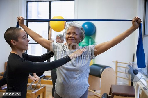 istock Senior african-american  woman doing exercise 1256519758