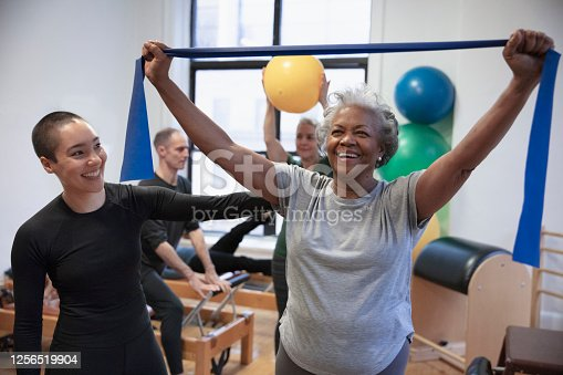istock Senior african-american  woman doing exercise 1256519904