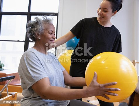 istock Senior african-american  woman doing exercise 1256523622