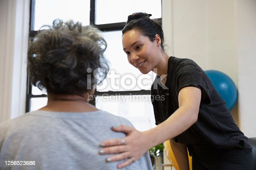 istock Senior african-american  woman doing exercise 1256523686