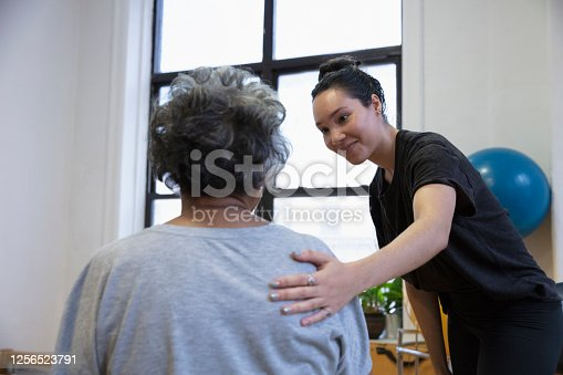 istock Senior african-american  woman doing exercise 1256523791