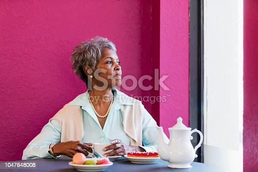 istock Senior African-American woman drinking coffee 1047648008