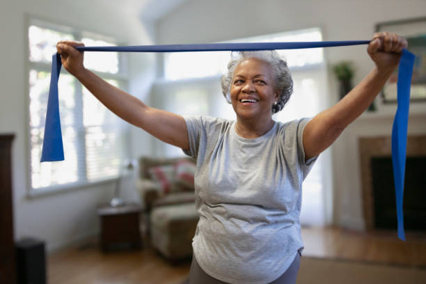 Senior african-american woman exercising inside the house