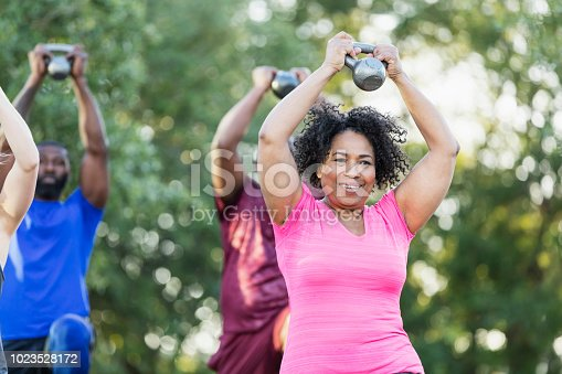 istock Senior African-American woman in exercise class 1023528172