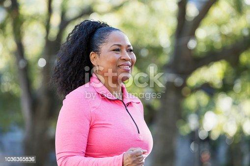 851958232istockphoto Senior African-American woman jogging outdoors 1036365836