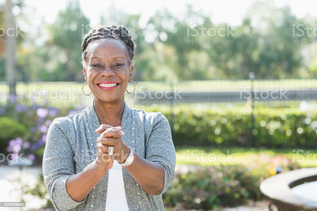 Senior African-American woman standing outdoors stock photo