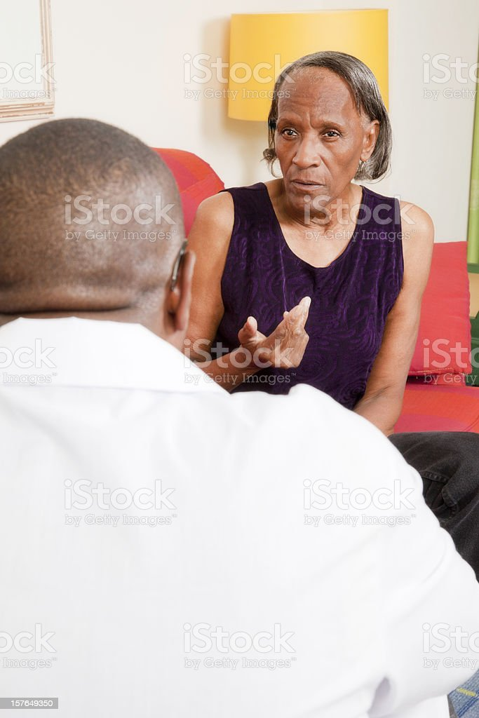 Senior african-american woman talking to a therapist royalty-free stock photo