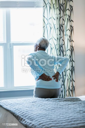 949450544istockphoto Senior African-American woman with sore back 1172339868