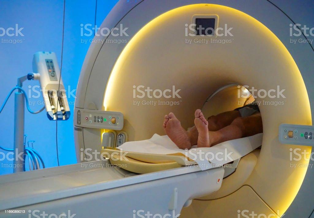 Senior man laying on MRI Scanner or Magnetic resonance imaging...