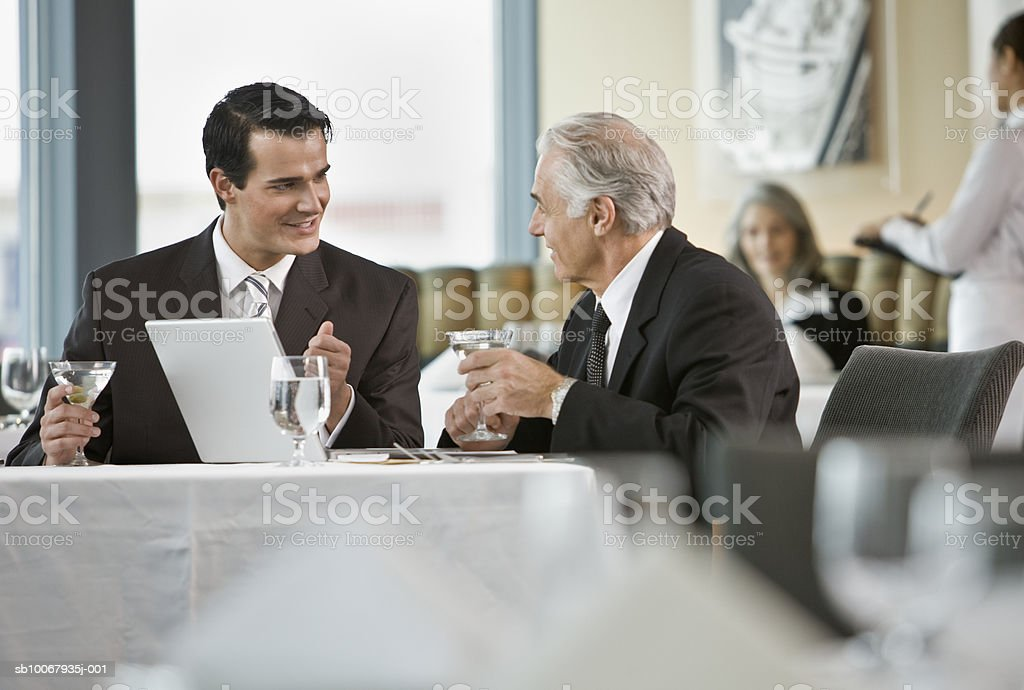 Senior an young business man talking in restaurant royalty-free stock photo