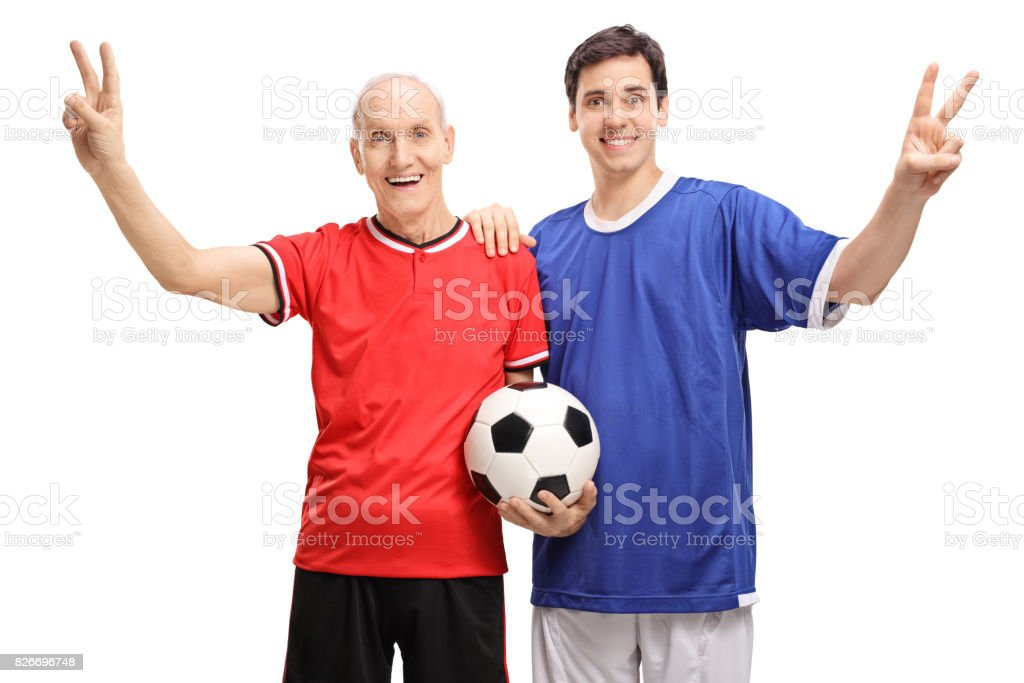 Senior and a young man making victory signs stock photo