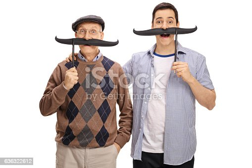 istock Senior and a young man posing with big fake moustaches 636322612