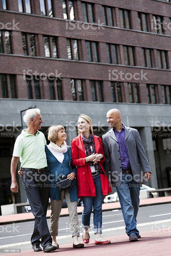 Senior and Adult Couples Walking in the City royalty-free stock photo