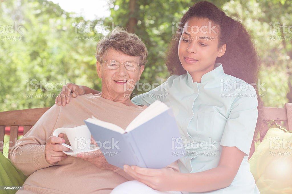 Senior and relax in garden stock photo