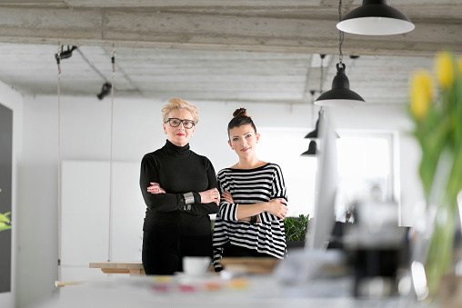 Senior And Young Designers In The Studio Stock Photo - Download Image Now