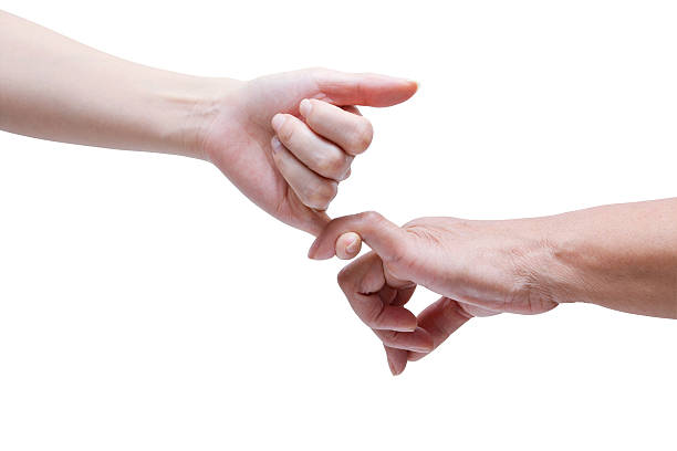 senior and young hands promise (clipping path!) isolated on white - pinky promise stock photos and pictures