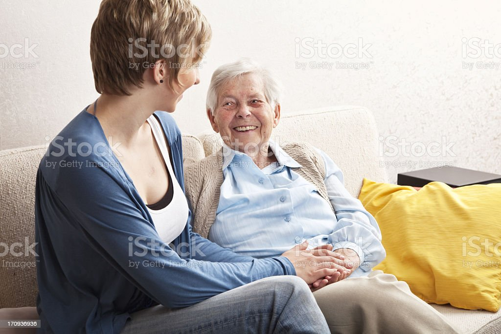 senior and young woman together royalty-free stock photo
