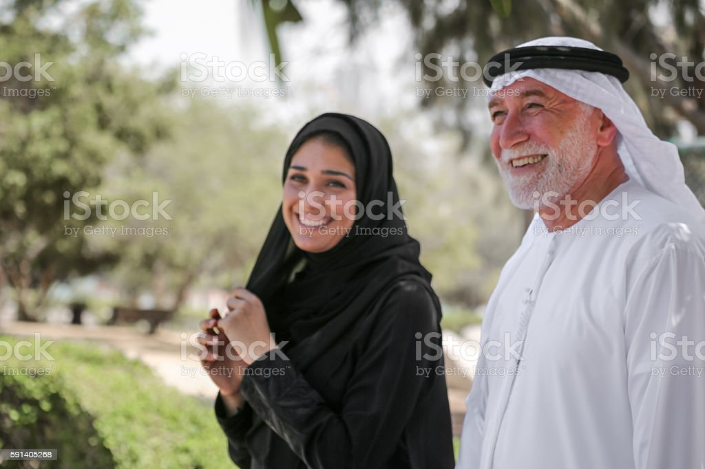 Senior arab man and young woman stock photo