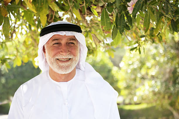 Senior arab man in a green park stock photo