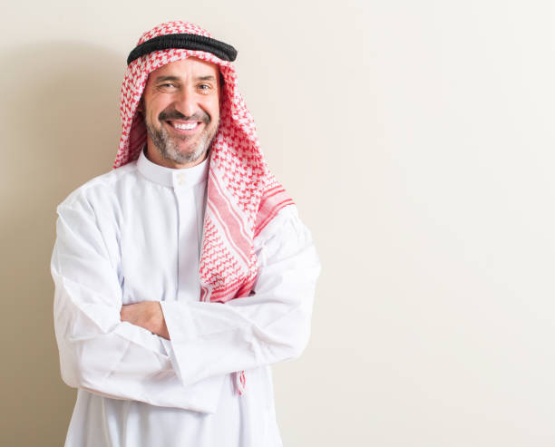 Senior arabic man with a happy face standing and smiling with a confident smile showing teeth Senior arabic man with a happy face standing and smiling with a confident smile showing teeth saudi arabia stock pictures, royalty-free photos & images