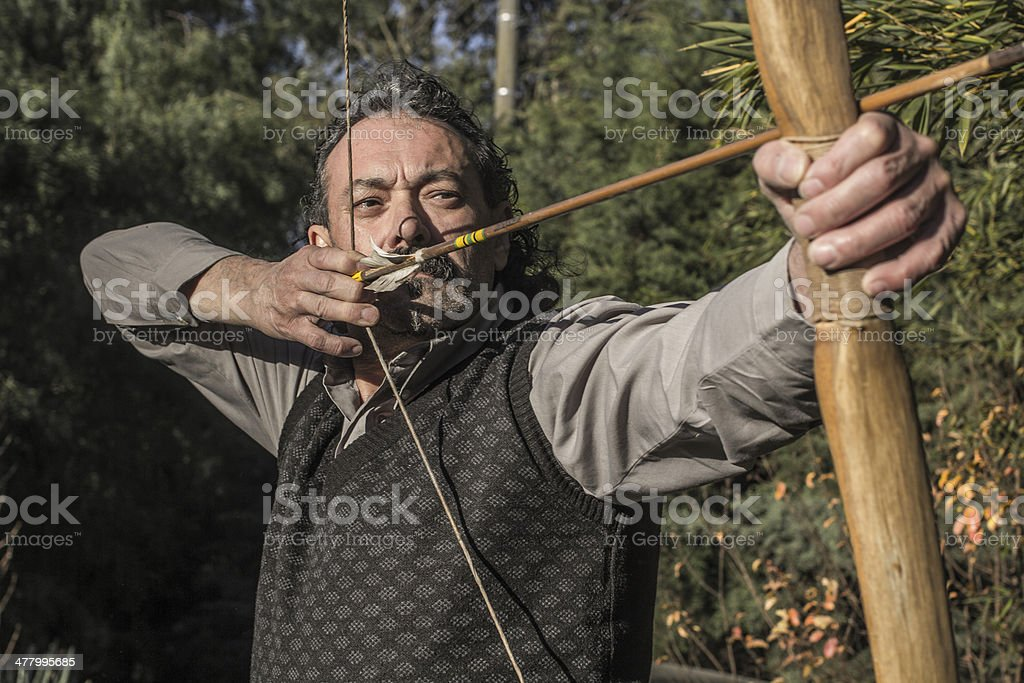 Senior archer with Arrow and Bow royalty-free stock photo