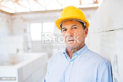 istock Senior architect or civil engineer on the construction site. 860481462