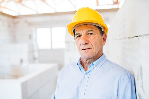 istock Senior architect or civil engineer on the construction site. 860481462