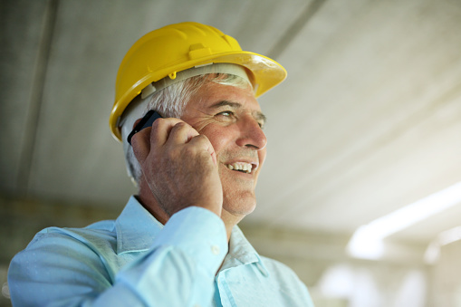 Senior businessman talking on mobile phone.