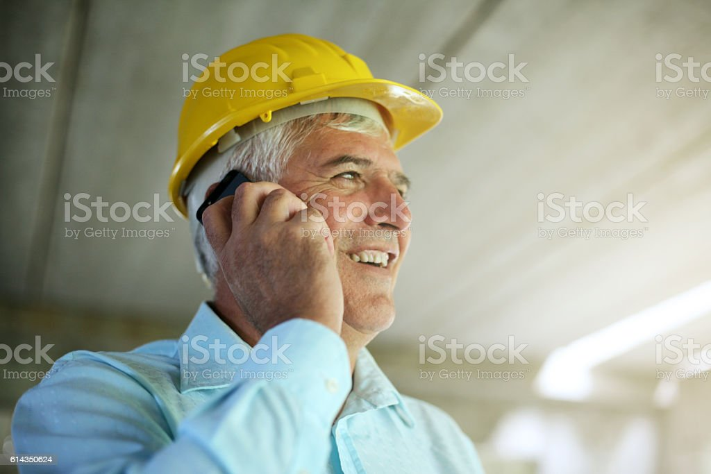 Senior architect using smart phone. stock photo