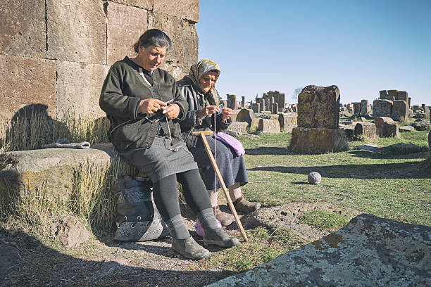 Senior Armenian Women Knitting and Talking Noratus Cemetery, Armenia armenian ethnicity stock pictures, royalty-free photos & images