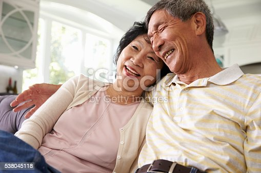 istock Senior Asian Couple At Home Relaxing On Sofa Together 538045118