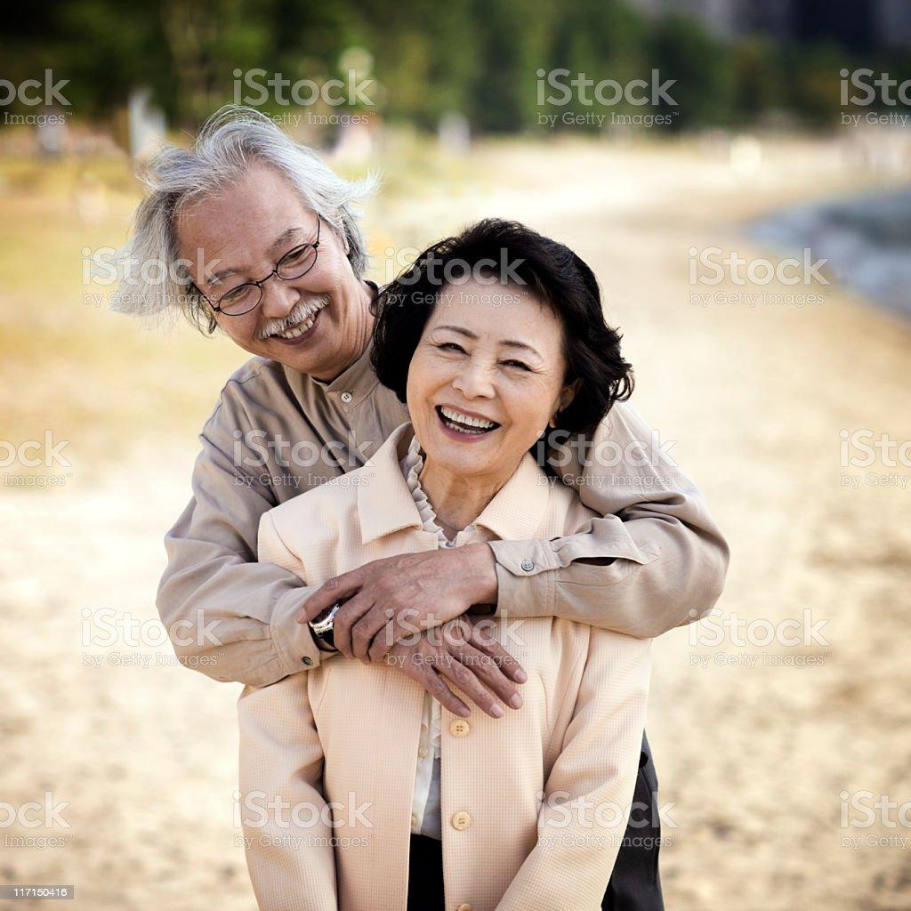 Senior Asian Couple at the Beach royalty-free stock photo
