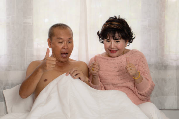 senior asian couple exiting with husband morning penis erection and both are very happy senior asian couple exiting with husband morning penis erection and both are very happy Dick stock pictures, royalty-free photos & images