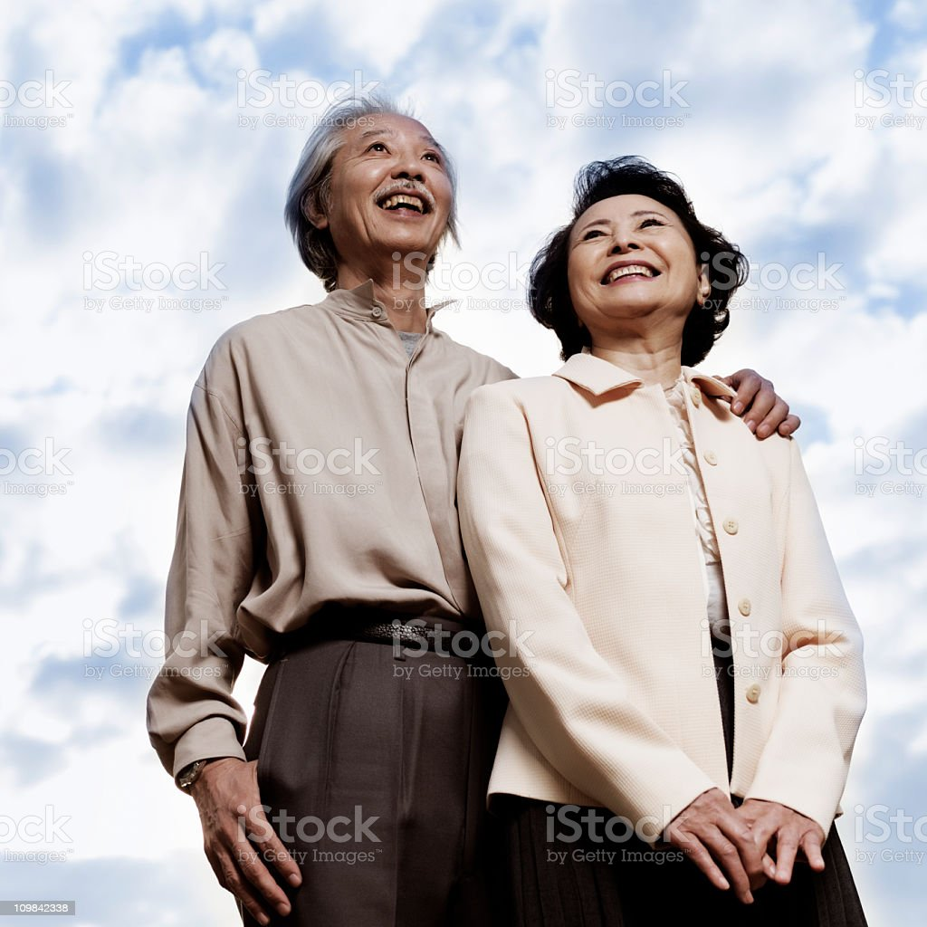 Senior Asian Couple Looking Standing Together stock photo