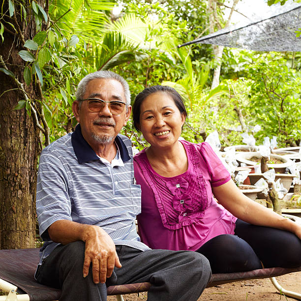 Senior Asian couple smiling together stock photo